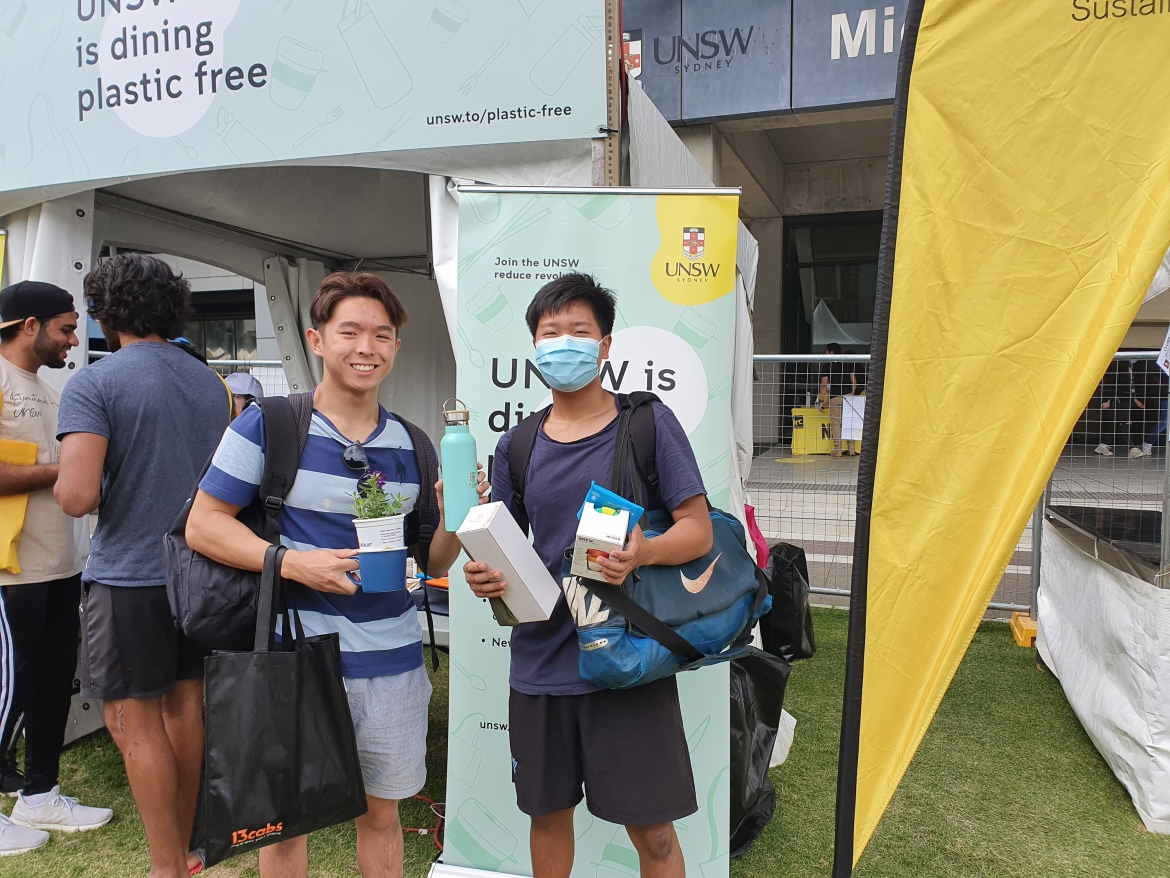 Two students standing in front of Plastic Free UNSW O-Week Stall