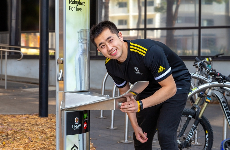 UNSW student drinking from water bubbler